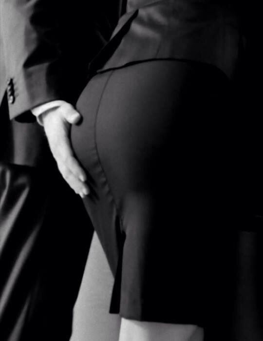 Pencil skirt meets his hand.