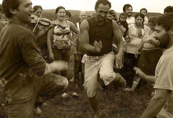 Gypsy men dancing.