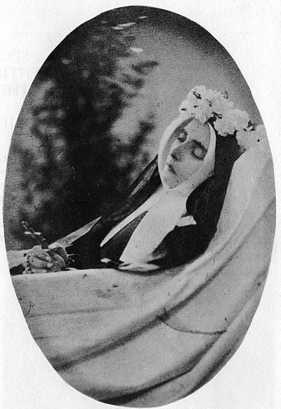 SAINT BERNADETTE Intact, as if she had just gone to sleep, and awaits only the angel's call to rise to her feet. God did not want her to escape totally from our human wretchedness, nor leave her brothers and sisters for whom she gave her life. She is still among us — A. Ravier, S.J.