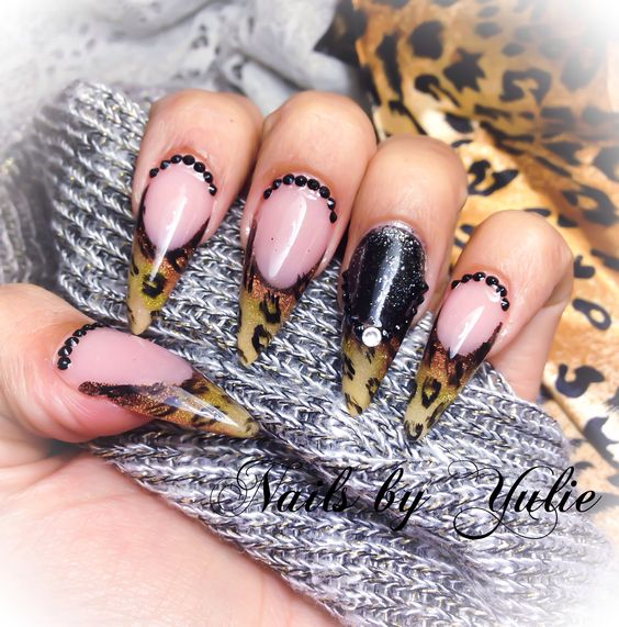 NEW NEW NEW NEW NEW NEW NEW NEW NEW NW   New cheetah-leopard print. Free style my way. New design. Colors bronze and golds. Black solid diamonds.   Try out the the animal print  P.S. My nails.