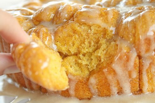 Pumpkin pull-apart monkey bread with maple glaze. Perfect for fall!!