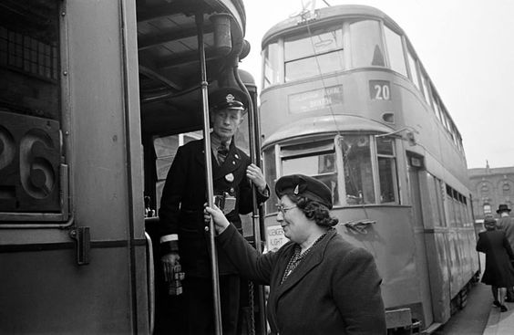 13th June 1946: Office cleaner Mrs. Packham seen boarding a tram at Vauxhall, on her way to her cleaning job in Central London.