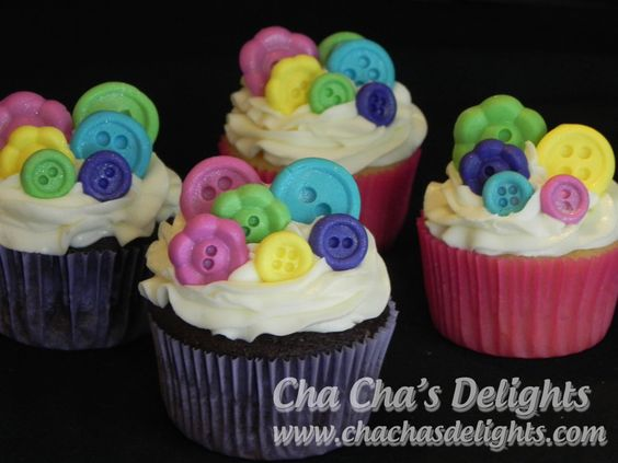 Vanilla and chocolate cupcakes with fondant button toppers.