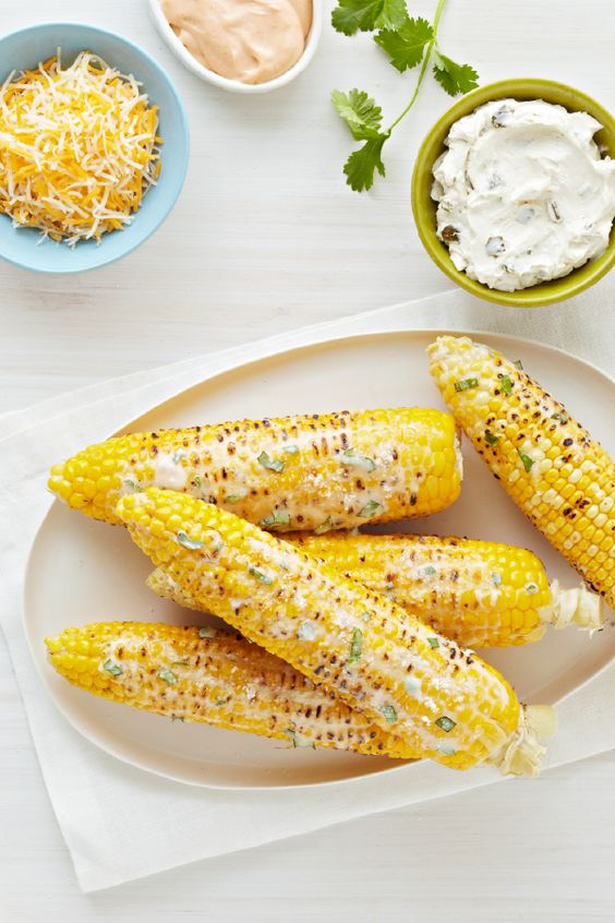 to corn on the cob by rolling buttered ears in grated Parmesan cheese ...