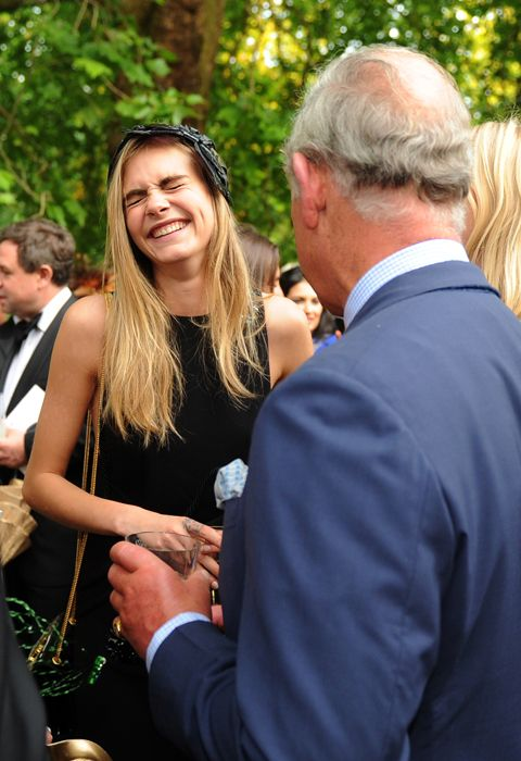 Cara Delevingne with Prince Charles, Prince of Wales at a reception hosted by The Prince of Wales and Duchess of Cornwall at Clarence House on July 09, 2013 in London, England