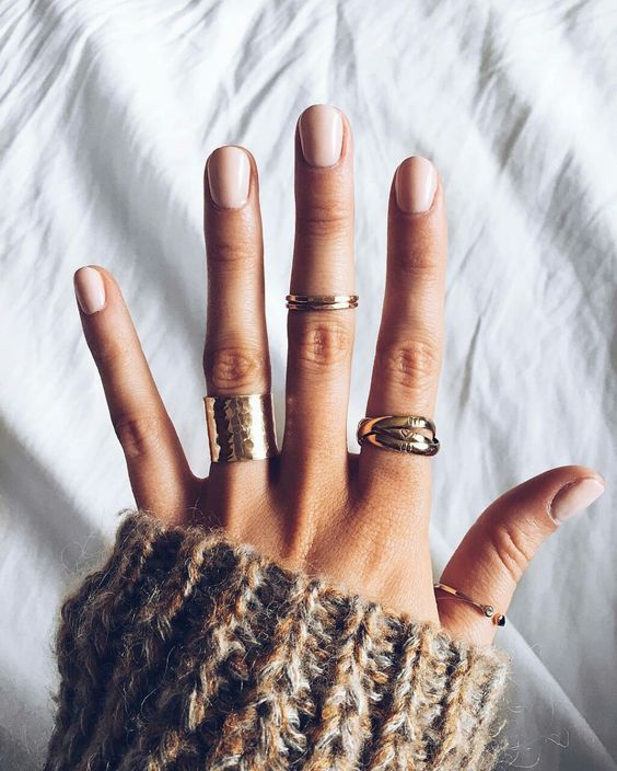 Natural manicure w/ nontoxic polish, gold rings and a chunky sweater = fall favorites.