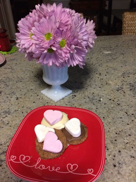 S'mores with homemade graham crackers, dipped 1/2 in white chocolate and 1/2 milk chocolate. Heart shaped marshmallows. Perfect for Valentines Day!!! We had them for our dessert tonight - toasted the marshmallows at the fireplace.