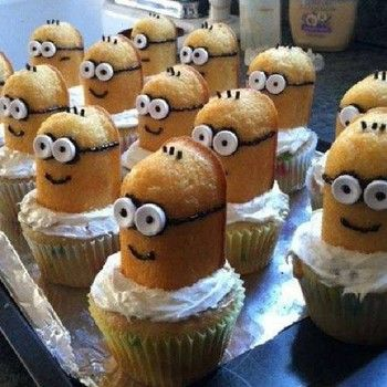 Cut Twinkies in half. Place one half with the rounded side facing up into the middle of the icing on each cupcake. Cut mini marshmallows in half and attach them to the face of each minion using a dot of icing for the eyes. Draw hair, a mouth and glasses on each face using black icing.