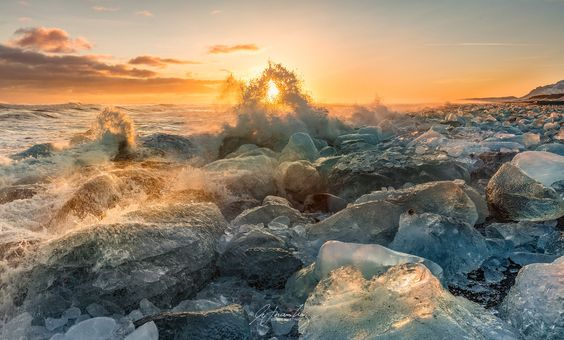 An end of a windstorm brought so many ice on the beach parallel to the lagoon. It created a massive wall of ice that photographers can't get any wave action. This is my different take of the famous diamond/ice beach.  Enjoy!