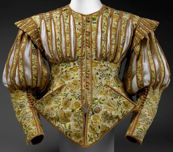 Doublet, early 1620s, French, silk. Length at CB: 19 3/4 in. (50.2 cm), one of only two surviving examples of its type from the 1620s. The only other known example is in the Victoria and Albert Museum. Made of luxurious silk embellished with pinking and decorative slits, this doublet followed a fashion that existed barely five years. Pinking, or the intentional slashing of fabric, was a popular decorative technique used to reveal colorful linings, shirts, and chemises. Met Museum.