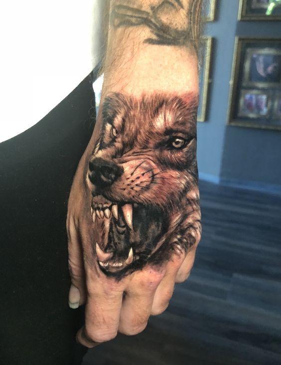 Wolf Hand Tattoo By Stefan Limited Availability Revelation Tattoo Studios Northampton Hand Tattoos Wolf Tattoo Wolf Tattoo Design