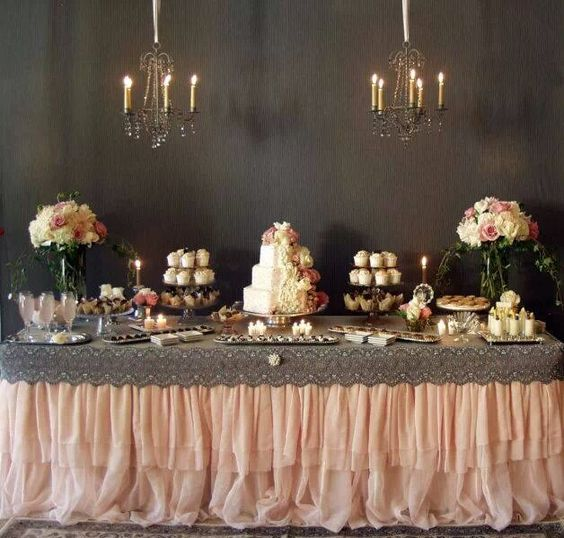 How chic is the grey lace over this blush colored table skirt? #laceweddings