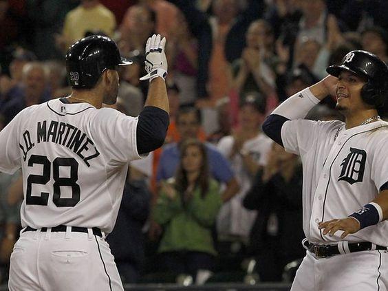 Detroit Tigers J. D. Martinez celebrates with Victor