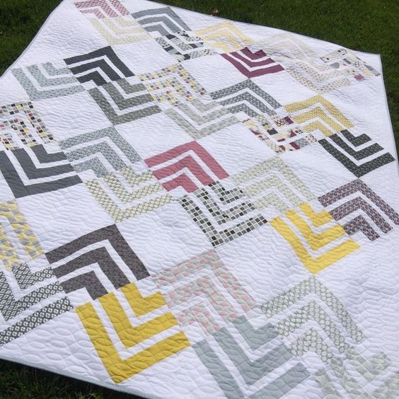 Layer Cake and modern Neutrals in this fresh quilt