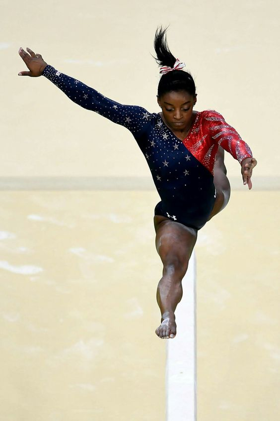 RIO DE JANEIRO, BRAZIL - AUGUST 07: Simone Biles of the United States competes on the balance beam during Women's qualification for Artistic Gymnastics on Day 2 of the Rio 2016 Olympic Games at the Rio Olympic Arena on August 7, 2016 in Rio de Janeiro, Brazil (Photo by David Ramos/Getty Images)