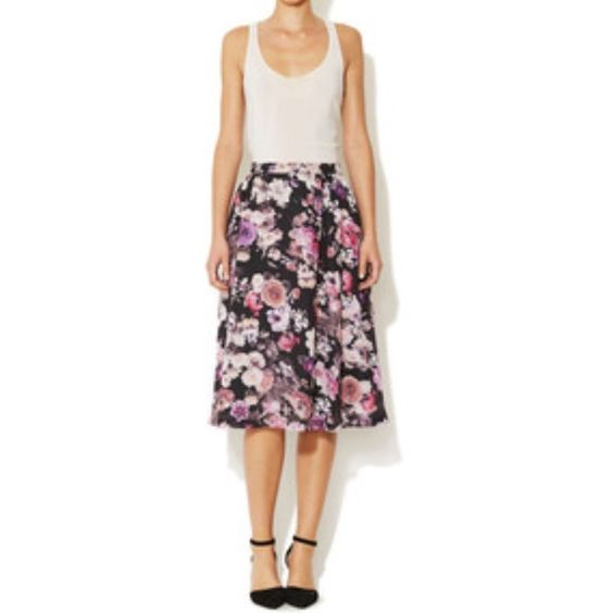 "Ava & Aiden Floral Printed Midi Skirt Woven polyester skirt. Floral graphic print throughout. Banded waist. Tonal topstitching and panel seaming. Hidden back zipper closure. Fully lined. Even hem Measurements. From waist to hem 27.5"". Waist 30"". Dry clean only. Ava & Aiden Skirts Midi"