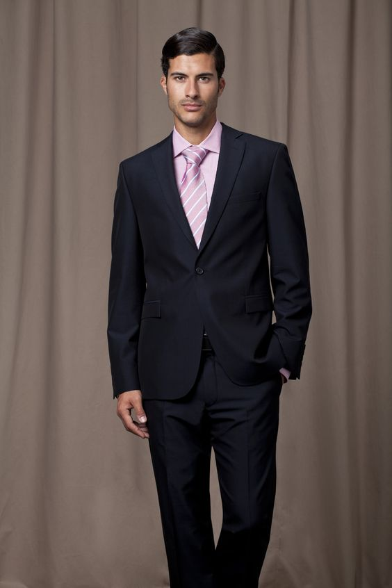 Black, one bottoned suit, with pink shirt and matching pink silk