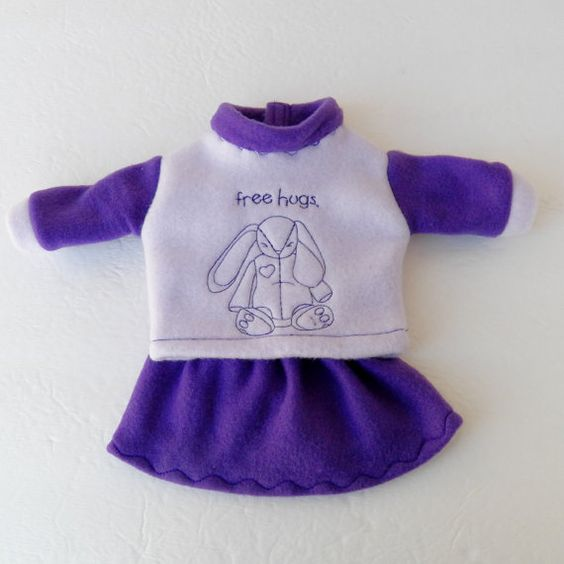 Fast shipping from a clean smoke free home  Made of cozy polar fleece, this cute embroidered bunny sweatshirt and skirt outfit has been made