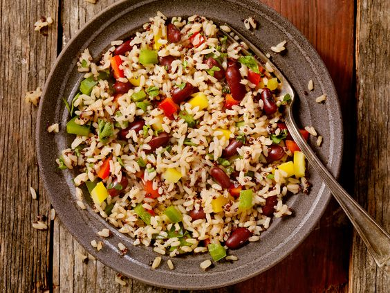 Give basic beans and rice an upgrade with vegetables and herbs to have even picky eaters asking for seconds.