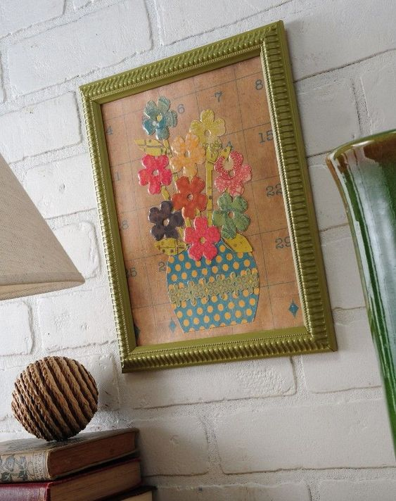 Use a dollar store frame, scrapbook paper and Mod Podge Dimensional Magic to create cute floral art.