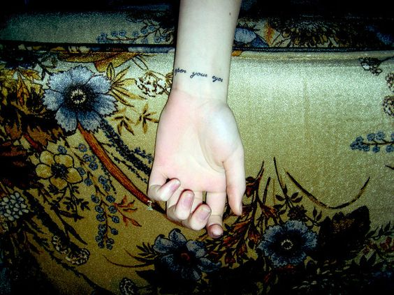 """open your eyes"" wrist tattoo"
