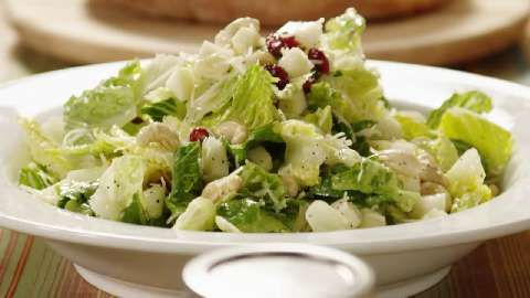 Apples, pears, and dried cranberries are tossed with romaine lettuce ...
