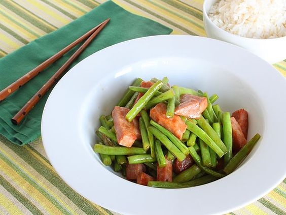Ham and Green Bean Stir Fry - Crunchy, salty, and a little bit spicy -- this sizzling stir fry comes together just as quickly as waiting for the delivery guy to ring the doorbell, and because you made it yourself, you definitely know there's no MSG in this meal!