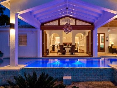 Have dinner overlooking the colorfully-lit pool, Sapphire Sunsets Beach Villa is a newly renovated luxury villa right on beautiful Sapodilla Beach in Providenciales.