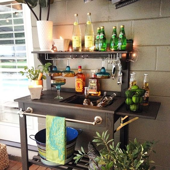potting table world market turned into a beverage bar for the patio