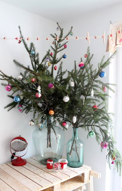 Holiday Decor for small spaces.  Put branches in a vase to create your own tree.: