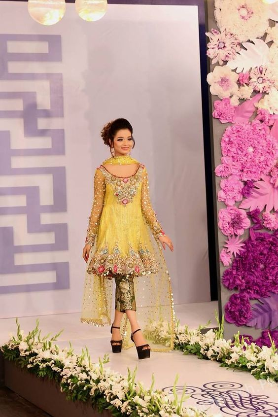 Light yellow net embroidered short frock with green banarsi
