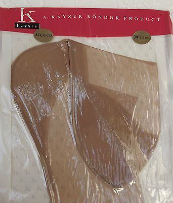 One pair of Bend-Easy stockings still sealed in the original packet Made in England by Kayser Bondor in or around 1953 - they carry the Royal Warrant