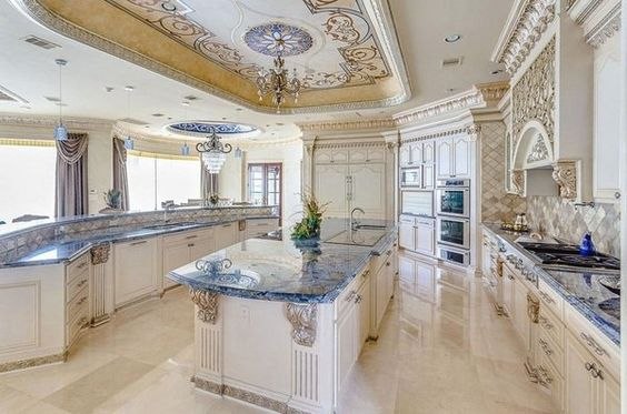 luxury Mediterranean kitchen design white cabinets ornate ceiling blue countertops