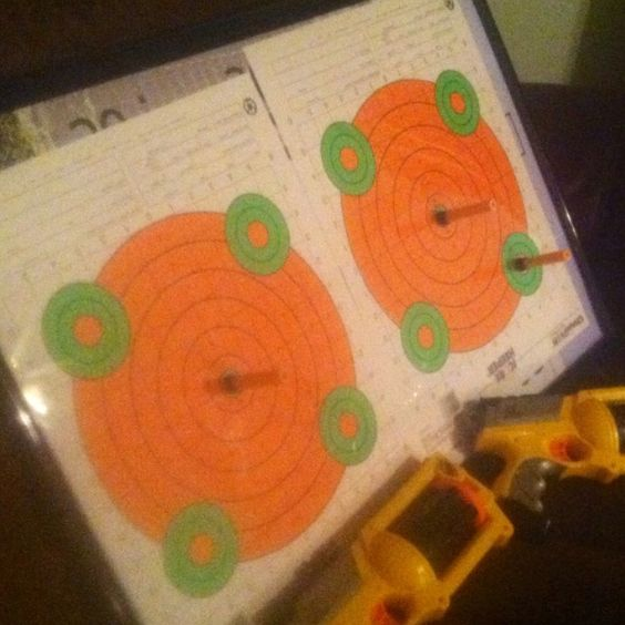 nerf target made with poster frame from walmart and fluorescent gun range targets works great