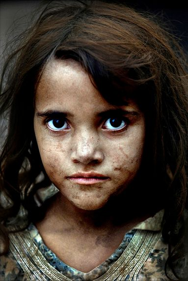 An Afghan refugee girl at a camp for displaced people across the border to…: