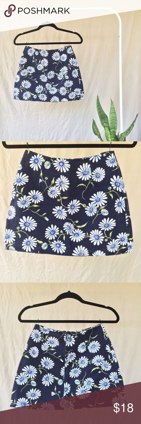 • Vintage • Daisy Floral Mini Skirt • ➕ Vintage 90s ➕ Pandora Casuals      ➕ listed as size medium, fits like x small ➕ 100 % cotton   ➕ subtle waffle knit texture    ➕ deep dark navy (almost black) color    ➕ white daisy floral pattern    ➕ w blue, yellow and green detailing    ➕ perfectly tapered to flatter hips and booty   ➕ fabric has small amount of stretch   ➕ hidden back zipper  ➕ super flattering 90s style    ➕ subtle thread pulls    ➕ (see last photo for example ) ➕ Measurements…