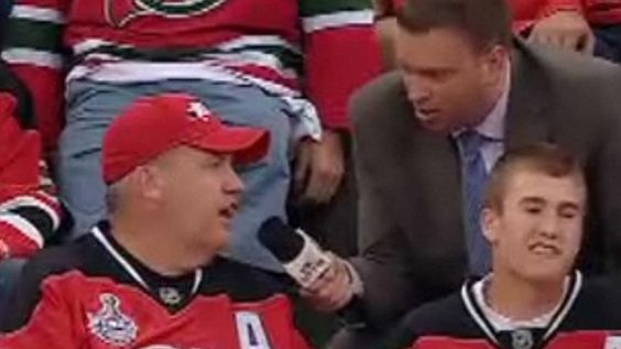 New York Jets coach Rex Ryan chats with Elliotte Friedman during Game 1 of the Cup final in New Jersey. (CBC)