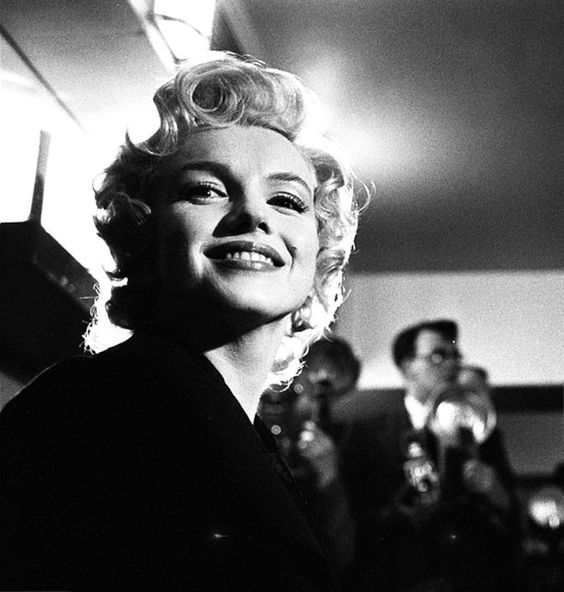 "Marilyn Monroe at a Press Conference at the Savoy Hotel in London to publicize her forthcoming film ""The Prince And The Showgirl"", 1956."
