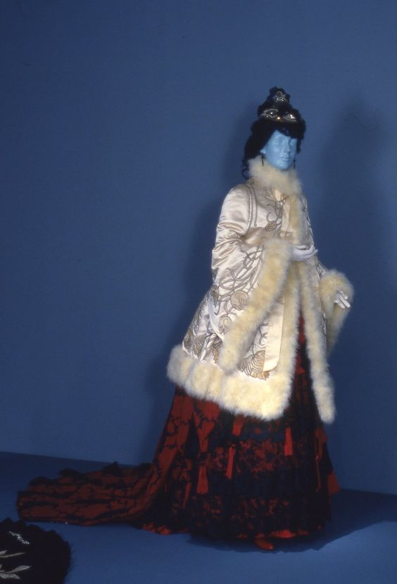 "Opera cloak by Emile Pingat, c. 1882, owned by the Met, displayed with unknown dress. From the ""Opulent Era: Fashions of Worth, Doucet and Pingat"" exhibition at the Brooklyn Museum."
