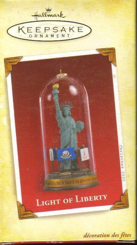 Hallmark Keepsake Light of Liberty Military Ornament  Lady Liberty's light has shone for generations as a beacon of freedom to the world. But our freedom comes at a cost, paid time and again by the men and women of our Army, Navy, Marine Corps, Air Force, and Coast Guard. Only through their courage has democracy been defended. Only through their service has liberty's torch continued to shine. Handcrafted Dated 2005.