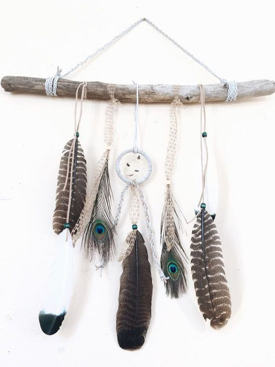 "The ultimate boho chic piece for any Gypsy Soul, adding  a natural, rustic touch to any room decor!  This handmade piece features a 3"" white leather dreamcatcher with beautiful stones and a lovely mixture of wild turkey & peacock feathers with braided leather & tweed. And of course, a large piece of driftwood handpicked off the shores of Lake Erie.:"