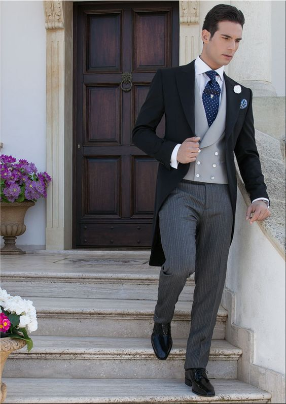 Black pure wool (extra satin) Morning suit combined with striped trouser (half-etiquette). Double-breasted waistcoat with mother of pearl buttons, silk jacquard tie with cashmere handkerchief and white extra satin cotton shirt special gala (non-iron) with classic collar and double cuff.