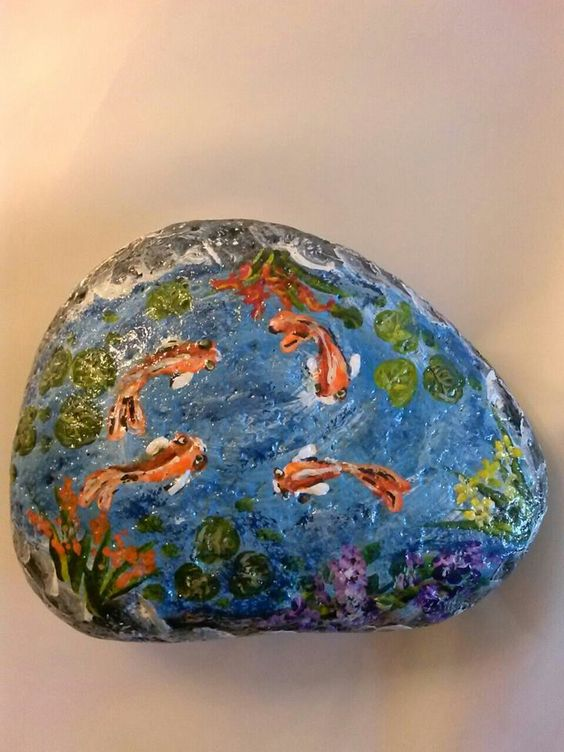 Painted a little koi pond on this rock by joanne boyer for Koi fish pond rocks