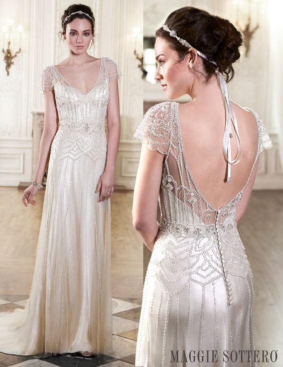 Slinky satin, sparkling Swarovski crystals and delicate illusion tulle...This stunning vintage inspired wedding dress is an absolute must. Read more now!