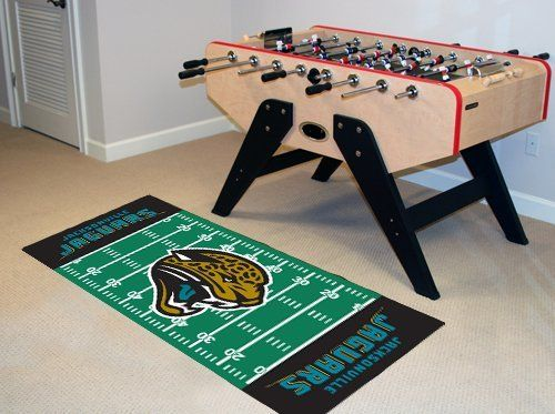 """Jacksonville Jaguars Runner 30""""x72"""" by Fanmats. $39.27. Jacksonville Jaguars Runner 30""""x72""""For all those football fans out there: football field-shaped area rugs by FANMATS. Made in U.S.A. 100% nylon carpet and non-skid recycled vinyl backing. Machine washable. Officially licensed. Chromojet printed in true team colors. Please note: These products are custom made. The normal lead time is about 7-10 business days. However, the putting mats and carpet tiles do take a little longer,..."""