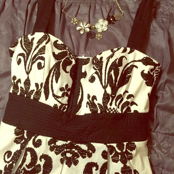 ✨ON HOLD UNTIL 3/25✨ Black and White Tea Dress Classy afternoon party dress. Has decorative hook closure on bust, a wide ribbon that ties in the back and one row of crinoline for a little extra poof. Zipper closure in the back. Has a little stretch in bust area. Great condition. New without tags. From a smoke free home. City Triangles Dresses