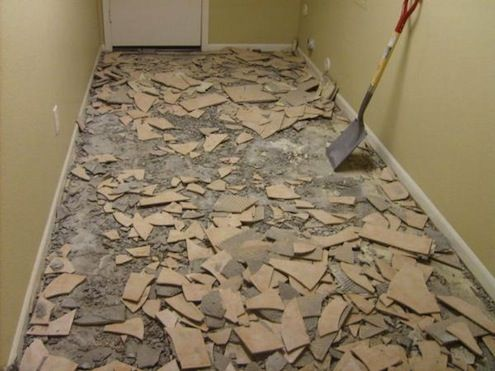 When removing tile, you might want to break out the sledgehammer and hope for the best, but a little patience can make the job much easier. Start by removing just a few tiles near an edge where the tile meets another type of flooring or wall material. Remove the grout around the tile with a rotary tool or grout saw and cut any caulking with a knife. Pry the tile off with a stiff putty knife or break it in pieces first with a hammer and cold chisel and then scrape off the pieces.