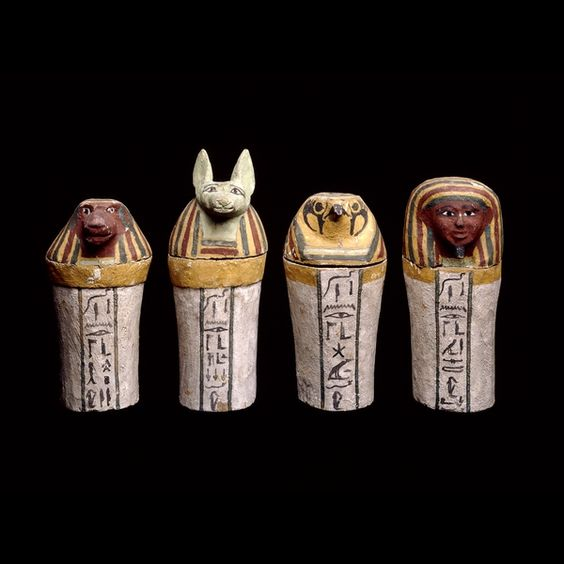 Painted wooden canopic jars 25th Dynasty, around 700 BC. The Sons of Horus were minor deities who protected the internal organs which were removed during the mummification process. These were embalmed in the same way as the body, wrapped and placed in stone or wooden jars, which were sometimes kept together in a canopic chest.
