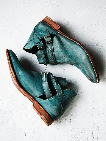 Braeburn Ankle Boot | Rugged leather ankle boots with cool open sides. Double ankle straps; adjustable, with brass buckles.  *By Free People
