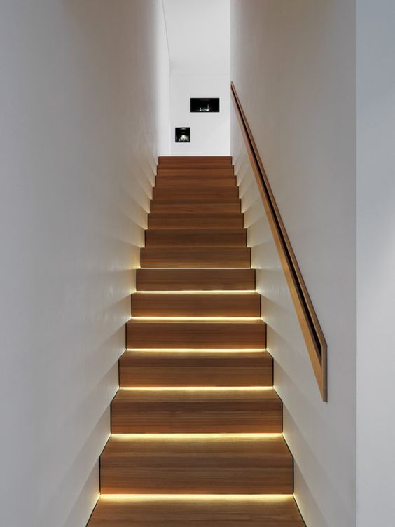 This lighting installation makes a boring staircase in a corridor look interesting besides adding a soft ambient lighting effect.  A cost effective application for a great look